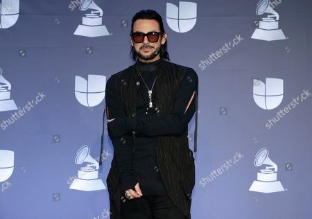 Beto Cuevas poses in the press room at the 20th Latin Grammy Awards, at the MGM Grand Garden Arena in Las Vegas