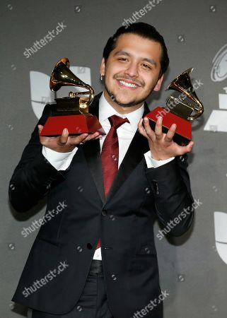 "Christian Nodal poses in the press room with the awards for best ranchero/mariachi album for ""Ahora"" and best regional song for ""No Te Contaron Mal"" at the 20th Latin Grammy Awards, at the MGM Grand Garden Arena in Las Vegas"