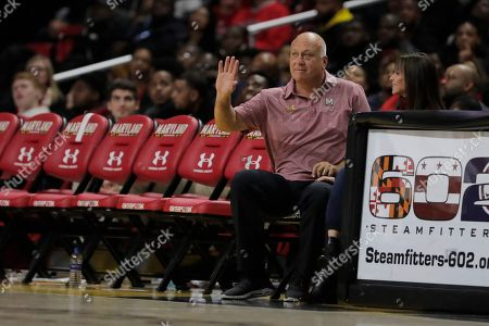 Stock Photo of Hall of Fame Baltimore Orioles shortstop Cal Ripken Jr., left, sits with his wife Laura S. Kiessling, Anne Arundel County, Md., circuit court judge, during the second half of an NCAA college basketball game between Maryland and Rhode Island, in College Park, Md. Maryland won 73-55