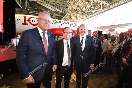 (L-R) Australian Prime Minister Scott Morrison, Qantas CEO Alan Joyce and Opposition Leader Anthony Albanese pose for photographers during the Qantas Centenary Launch at Qantas Jet Base in Sydney, Australia, 15 November 2019. A direct Qantas flight from London to Sydney successfully touched down in 19-and-a-half hours.