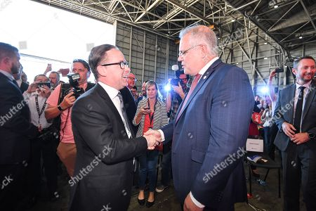 Qantas CEO Alan Joyce (L) and Australian Prime Minister Scott Morrison (R) converse during the Qantas Centenary Launch at Qantas Jet Base in Sydney, Australia, 15 November 2019. A direct Qantas flight from London to Sydney successfully touched down in 19-and-a-half hours.