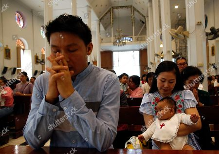 Editorial picture of Catholic baptism ceremony for Thai infants in Bangkok, Thailand - 03 Nov 2019