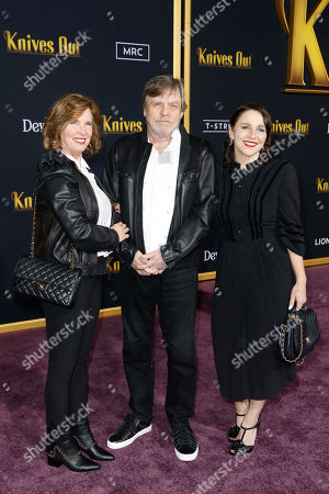 Mark Hamill (C) and Producer Marilou York (L) pose on the red carpet during the premiere of the movie 'Knives Out' at the Regency Village Theatre in Los Angeles, California, USA, 14 November 2019. The movie is set tp be released in US theaters on 27 November.