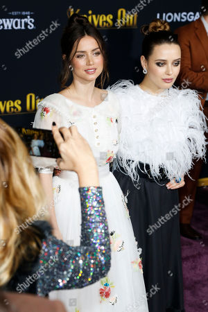 Katherine Langford (R) and Cuban actress Ana De Armas (L) pose on the red carpet during the premiere of the movie 'Knives Out' at the Regency Village Theatre in Los Angeles, California, USA, 14 November 2019. The movie is set to be released in US theaters on 27 November.