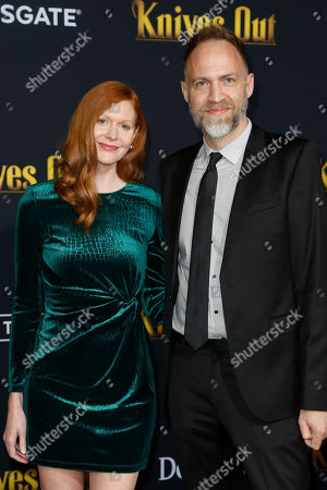 US music composer Nathan Johnson (R) and guest pose on the red carpet during the premiere of the movie 'Knives Out' at the Regency Village Theatre in Los Angeles, California, USA, 14 November 2019. The movie is set to be released in US theaters on 27 November.