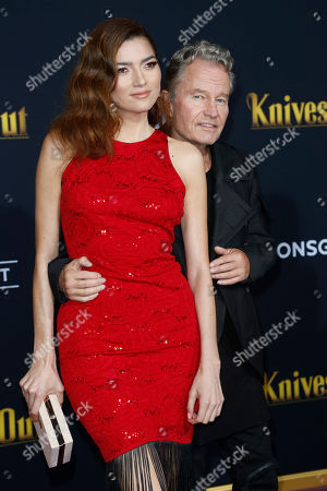 John Savage (R) and Blanca Blanco (L) pose on the red carpet during the premiere of the movie 'Knives Out' at the Regency Village Theatre in Los Angeles, California, USA, 14 November 2019. The movie is set to be released in US theaters on 27 November.