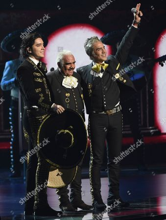 Stock Image of Vicente Fernandez, Alejandro Fernandez, Alex Fernandez. Vicente Fernandez, center, his son Alejandro Fernandez, right, and his grandson Alex Fernandez react after performing a medley at the 20th Latin Grammy Awards, at the MGM Grand Garden Arena in Las Vegas
