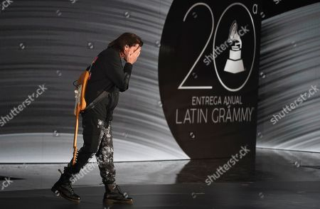 Juanes reacts as he accepts the award for person of the year at the 20th Latin Grammy Awards, at the MGM Grand Garden Arena in Las Vegas