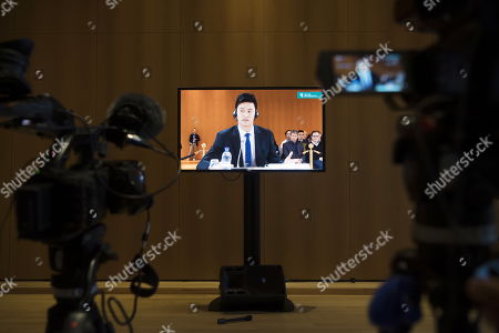 Chinese swimmer Sun Yang, is pictured on a TV screen during a public hearing at the Court of Arbitration for Sport, (CAS), in Montreux, Switzerland, 15 November 2019. One of China's three-time gold medalist swimmer Sun Yang is facing a World Anti-Doping Agency appeal in Switzerland that seeks to ban him for up eight years for allegedly refusing to give samples voluntarily.