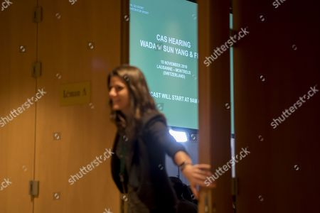 A CAS staff closes the door during a public hearing of Chinese swimmer Sun Yang at the Court of Arbitration for Sport (CAS), in Montreux, Switzerland, 15 November 2019. One of China's three-time gold medalist swimmer Sun Yang is facing a World Anti-Doping Agency appeal in Switzerland that seeks to ban him for up eight years for allegedly refusing to give samples voluntarily.