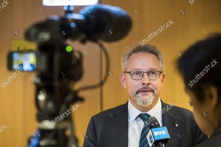 Matthieu Reeb, CAS General Secretary speaks to journalists during a public hearing of Chinese swimmer Sun Yang at the Court of Arbitration for Sport (CAS), in Montreux, Switzerland, 15 November 2019. One of China's three-time gold medalist swimmer Sun Yang is facing a World Anti-Doping Agency appeal in Switzerland that seeks to ban him for up eight years for allegedly refusing to give samples voluntarily.