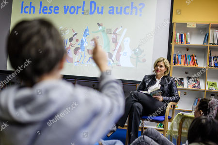 German Minister of Food and Agriculture Julia Kloeckner (R) has a group of children listening to her as she reads for pupils of the Fanny-Hensel elementary school during the Germany-wide 'Reading Aloud Day' (Vorlesetag) in Berlin, Germany, 15 November 2019. The countrywide 'Reading Aloud Day' which was officially launched in 2004 by the German Foundation Reading, the ZEIT weekly and the Foundation Deutsch Bahn is held annually on the third Friday in November and still aims at attracting people - mainly youngsters - for literature in form of the written and narrated words.