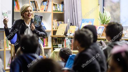 German Minister of Food and Agriculture Julia Kloeckner (L) has a group of children listening to her as she reads for pupils of the Fanny-Hensel elementary school during the Germany-wide 'Reading Aloud Day' (Vorlesetag) in Berlin, Germany, 15 November 2019. The countrywide 'Reading Aloud Day' which was officially launched in 2004 by the German Foundation Reading, the ZEIT weekly and the Foundation Deutsch Bahn is held annually on the third Friday in November and still aims at attracting people - mainly youngsters - for literature in form of the written and narrated words.
