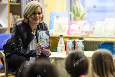German Minister of Food and Agriculture Julia Kloeckner has a group of children listening to her as she reads for pupils of the Fanny-Hensel elementary school during the Germany-wide 'Reading Aloud Day' (Vorlesetag) in Berlin, Germany, 15 November 2019. The countrywide 'Reading Aloud Day' which was officially launched in 2004 by the German Foundation Reading, the ZEIT weekly and the Foundation Deutsch Bahn is held annually on the third Friday in November and still aims at attracting people - mainly youngsters - for literature in form of the written and narrated words.