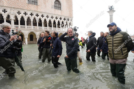 League leader Matteo Salvini (R) and Veneto Governor Luca Zaia (C) walk in high water in Venice, Northern Italy, 15 November 2019. Venice is to close St Mark's Square due to fresh flooding in the city. The city is currently suffering its second-worst floods on record, with the high-water mark reaching 187cm on Tuesday. The water level had dropped down significantly but it is forecast to go back up to 160cm on today.