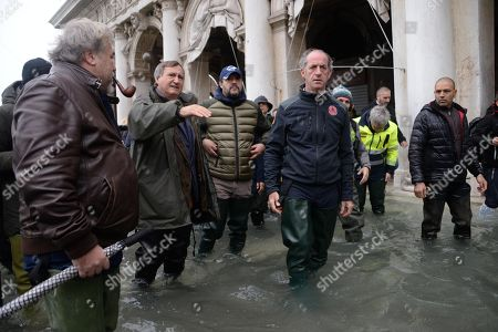 League leader Matteo Salvini (L-3), Veneto Governor Luca Zaia (C) and Venice Mayor Luigi Brugnaro (L-2) walk in high water as they inspect flood damage in Venice, Italy, 15 November 2019. Venice is to close St Mark's Square due to fresh flooding in the city. The city is currently suffering its second-worst floods on record, with the high-water mark reaching 187cm on Tuesday. The water level had dropped down significantly but it is forecast to go back up to 160cm on today.