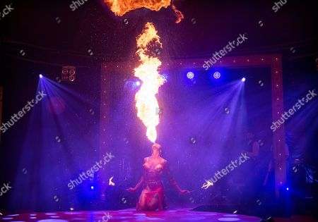 Stock Picture of La Clique, the Olivier Awards winning West End Cabaret, returns to London's Leicester Square.  Fire breather and sword swallower Heather Holliday.