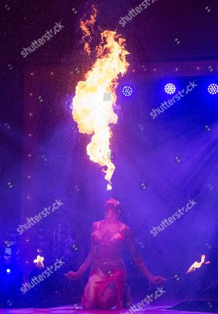 La Clique, the Olivier Awards winning West End Cabaret, returns to London's Leicester Square.  Fire breather and sword swallower Heather Holliday.