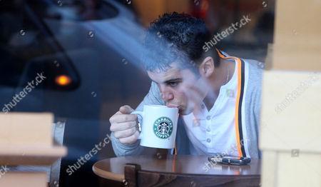 Joseph McElderry in a Starbucks coffee shop