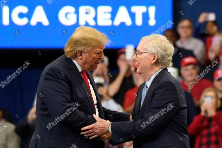 "Donald Trump, Mitch McConnell. President Donald Trump greets Senate Majority Leader Mitch McConnell of Ky., on stage during a campaign rally in Lexington, Ky. The paperback edition of McConnell's ""The Long Game"" includes a foreword from Trump. In the foreword, Trump praises the Kentucky Republican as an ideal partner in confirming conservative judges, notably Supreme Court Justices Neil Gorsuch and Brett Kavanaugh"