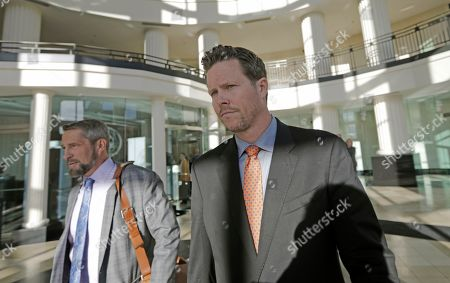 Paul Petersen, right, an Arizona elected official accused of running a multi-state adoption scheme, leaves court following an initial appearance on charges filed in the state, in Salt Lake City. Prosecutors in three states say Petersen brought pregnant women from the Marshall Islands to the United States and paid them to give up their babies for adoption. He's pleaded not guilty