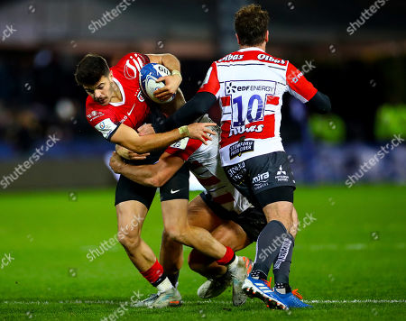 Gloucester vs Toulouse. Toulouse's Romain Ntamack is tackled by Chris Harris and Danny Cipriani of Gloucester