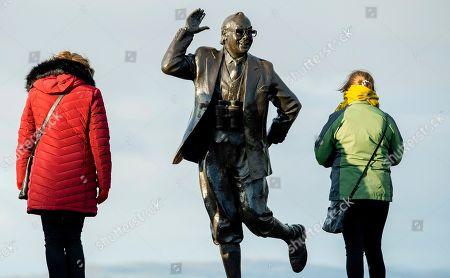 Editorial image of Eric Morecambe statue in Morecombe Bay, United Kingdom - 15 Nov 2019