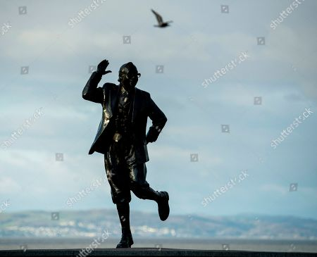 A view of the statue of British comedian Eric Morecombe which stands in one of his characteristic poses with a pair of binoculars around his neck, as he was a keen ornithologist, in Morecombe Bay, Britain, 15 November 2019.