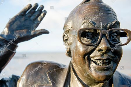 Stock Photo of A view of the statue of British comedian Eric Morecombe which stands in one of his characteristic poses with a pair of binoculars around his neck, as he was a keen ornithologist, in Morecombe Bay, Britain, 15 November 2019.