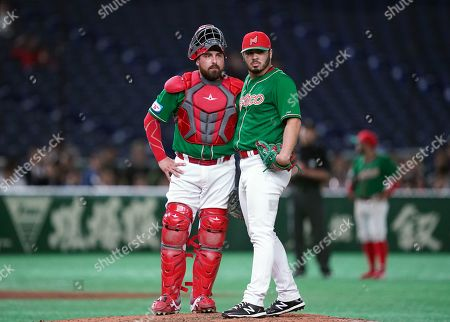Felipe Gonzalez of Mexico, pitcher, (R) and Roman Solis of Mexico, catcher, (L) during the 5th inning