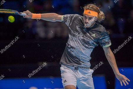 Stefanos Tsitsipas (GRE) in action during his match with Rafael Nadal (ESP). Andre Agassi group stage match between Rafael Nadal (ESP) (1) and Stefanos Tsitsipas (GRE) (6).
