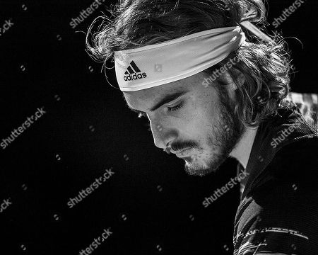 Monochrome Image of Stefanos Tsitsipas (GRE) during his match with Rafael Nadal (ESP). Andre Agassi group stage match between Rafael Nadal (ESP) (1) and Stefanos Tsitsipas (GRE) (6).