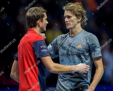 Stock Picture of Daniil Medvedev (RUS) congratulates Alexander Zverev (GER) at the net after their match.  Andre Agassi group stage match between Daniil Medvedev (RUS) (4) and Alexander Zverev (GER) (7).