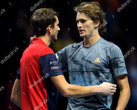 Daniil Medvedev (RUS) congratulates Alexander Zverev (GER) at the net after their match.  Andre Agassi group stage match between Daniil Medvedev (RUS) (4) and Alexander Zverev (GER) (7).