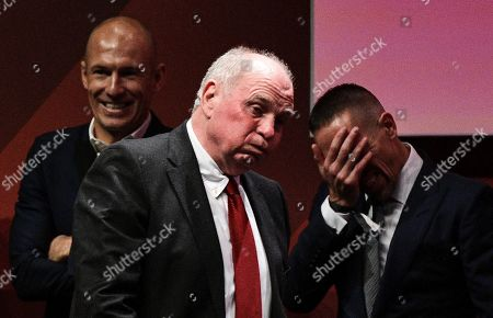 Munich's parting President Uli Hoeness (C) reacts as former players Arjen Robben (L) and Franck Ribery (R) look on during the FC Bayern Muenchen annual meeting in Munich, Germany, 15 November 2019.