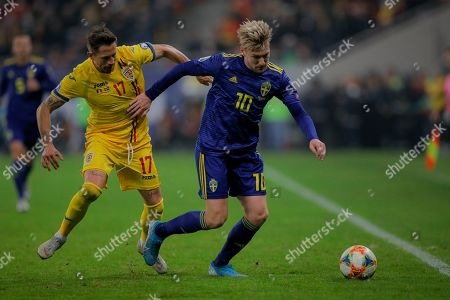 Romania's Ciprian Deac, left, Sweden's Emil Forsberg, right, during the Euro 2020 group F qualifying soccer match between Romania and Sweden on the National Arena stadium in Bucharest, Romania