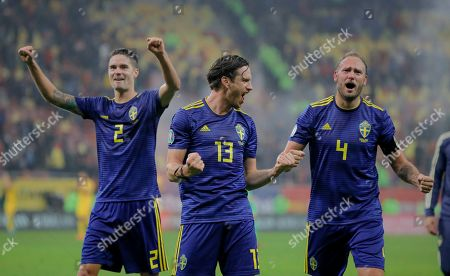 Sweden's Gustav Svensson, center, Mikael Lustig, left, and Andreas Granqvist celebrate after the Euro 2020 group F qualifying soccer match between Romania and Sweden on the National Arena stadium in Bucharest, Romania