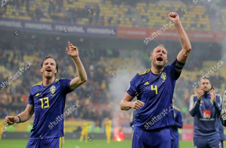 Stock Image of Sweden's Gustav Svensson, left, and Andreas Granqvist celebrate after the Euro 2020 group F qualifying soccer match between Romania and Sweden on the National Arena stadium in Bucharest, Romania