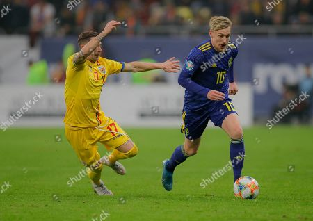 Romania's Ciprian Deac, left, challenges for the ball with Sweden's Emil Forsberg,right, during the Euro 2020 group F qualifying soccer match between Romania and Sweden on the National Arena stadium in Bucharest, Romania