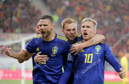 Sweden's Marcus Berg, left, and Sweden's Emil Forsberg celebrates after scoring his side's first goal during the Euro 2020 group F qualifying soccer match between Romania and Sweden on the National Arena stadium in Bucharest, Romania