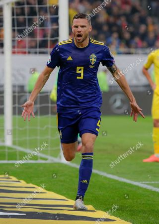 Stock Photo of Sweden's Albin Ekdal celebrates after scoring his side's first goal during the Euro 2020 group F qualifying soccer match between Romania and Sweden on the National Arena stadium in Bucharest, Romania