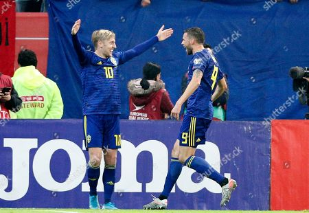 Sweden's  Marcus Berg (R), assisted by Emil Forsberg (L),  reacts after scoring against Romania's  during the UEFA EURO 2020 group F qualifying soccer match between Romania and Sweden, at National Arena stadium in Bucharest, Romania, 15 November 2019.