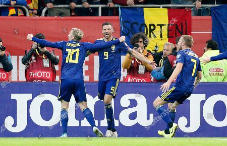 Sweden's  Marcus Berg (C), assisted by Emil Forsberg (L) and Sebastian Larsson (R),  reacts after scoring against Romania's  during the UEFA EURO 2020 group F qualifying soccer match between Romania and Sweden, at National Arena stadium in Bucharest, Romania, 15 November 2019.