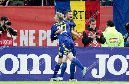 Sweden's  Marcus Berg (R), assisted by Emil Forsberg (L with 10 ),  reacts after scoring against Romania's  during the UEFA EURO 2020 group F qualifying soccer match between Romania and Sweden, at National Arena stadium in Bucharest, Romania, 15 November 2019.
