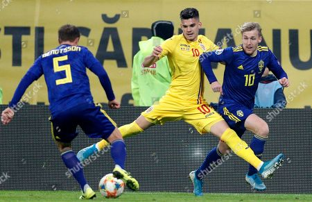 Sweden's Pierre Bengtsson (L) and Emil Forsberg (R) in action against Romania's Ianis Hagi (C) during the UEFA EURO 2020 group F qualifying soccer match between Romania and Sweden, at National Arena stadium in Bucharest, Romania, 15 November 2019.
