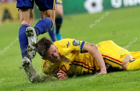 Sweden's Albin Ekdal (R) in action against Romania's Ciprian Deac (R) during the UEFA EURO 2020 group F qualifying soccer match between Romania and Sweden, at National Arena stadium in Bucharest, Romania, 15 November 2019.