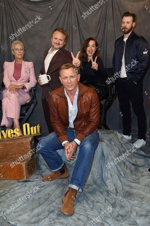 """Jamie Lee Curtis, Rian Johnson, Ana de Armas, Chris Evans, Daniel Craig. Jamie Lee Curtis, from top left, director Rian Johnson, Ana de Armas, Chris Evans and Daniel Craig attend the """"Knives Out"""" photo call at the Four Seasons Hotel, in Los Angeles"""