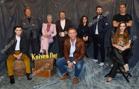 """Jaeden Martell, Don Johnson, Jamie Lee Curtis, Rian Johnson, Ana de Armas, Chris Evans, Michael Shannon, Katherine Langford. Jaeden Martell, from left, Don Johnson, Jamie Lee Curtis, Rian Johnson, Ana de Armas, Chris Evans, Michael Shannon and Katherine Langford attend the """"Knives Out"""" photo call at the Four Seasons Hotel, in Los Angeles"""