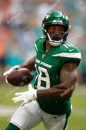 New York Jets wide receiver Demaryius Thomas (18) runs with the ball after a catch against the Miami Dolphins during an NFL football game, in Miami Gardens, Fla. The Dolphins won 26-18