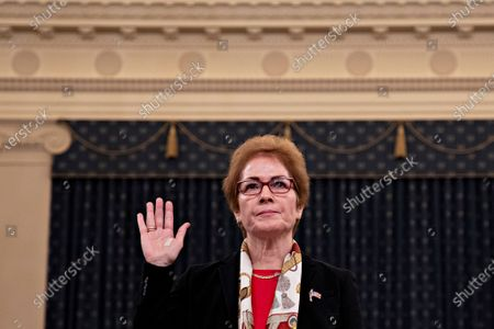 Marie Yovanovitch, former U.S. Ambassador to Ukraine, swears in to a House Intelligence Committee impeachment inquiry hearing in Washington, D.C., U.S.,. Yovanovitch testified in private on October 11 that she was called back to Washington after a 'concerted campaign' by President Trump and his allies, including Rudy Giuliani, according to a transcript released later.